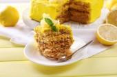 Tasty lemon dessert on wooden table — Stock Photo