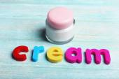 Cream word formed with colorful letters — Stock Photo