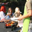 Young friends having barbecue party, outdoors — Stock Photo #57579741