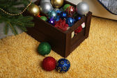 Christmas balls in festive interior — Stock fotografie