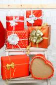 Christmas presents on ladder — Stock Photo
