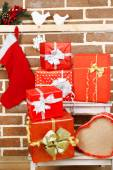 Christmas presents on stand ladder — Photo