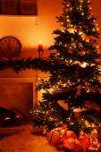 Christmas tree near fireplace — Photo