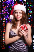 Portrait of beautiful young woman on bright lights background — Stock Photo