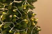 Christmas tree decorated with garlands — Stock Photo