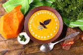 Pumpkin soup and pumpkin slice — Stock Photo
