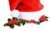 Mistletoe and Santa Claus hat — Stock Photo