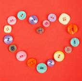 Buttons on red cloth — Stock Photo