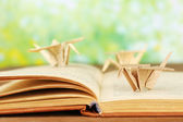 Origami cranes on old book — Foto Stock