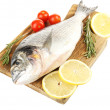 Fresh raw fish on cutting board and food ingredients isolated on white — Stock Photo #57619889