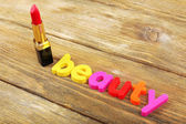 Beauty word formed with colorful letters on wooden background — 图库照片