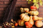 Pumpkins on stool on floor — Stock Photo