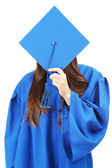 Graduate students wearing graduation hat and gown, isolated on white — Stockfoto