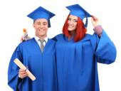 Graduate students wearing graduation hat and gown, isolated on white — Stock Photo