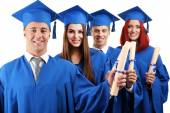 Students wearing graduation hat and gown — Stock Photo