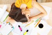 Tired woman sleeping on table — Stock Photo