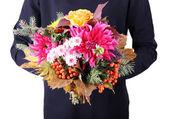 Man holding flowers — Stock Photo