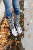Girl in rubber boots — Stock Photo