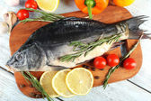 Fresh raw fish and food ingredients — Stock Photo