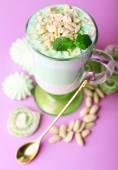 Mint milk dessert in glass, peanuts and mint jelly candies — Stock Photo