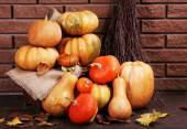 Pumpkins on stool on floor — Stock Photo
