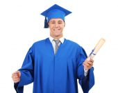 Man graduate student wearing graduation hat and gown, isolated on white — Stockfoto