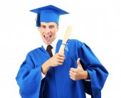 Man graduate student wearing graduation hat and gown, isolated on white — Stock Photo