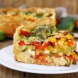 Piece of Vegetable pie with broccoli, peas, tomatoes and cheese — Stock Photo #57875471