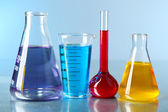 Laboratory glassware with colorful liquid — Stock Photo