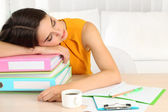 Tired girl with many folders — Stock Photo