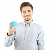 Handsome young man holds cutaway — Stock Photo