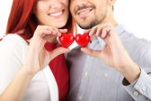 Loving couple with hearts — Stock Photo