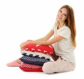 Beautiful young girl with pillows  isolated on white t background — Stock Photo