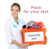 Girl volunteer with donation box  isolated on white — Foto Stock