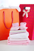 Baby clothes and gift bags — Foto de Stock