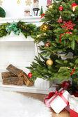Christmas tree near fireplace — Stock Photo