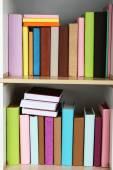 Books on wooden shelves — Stock Photo