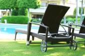 Lounge sunbeds near pool — Stock Photo
