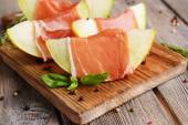 Delicious melon with prosciutto — Stock Photo