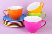 Colorful cups and saucers — Stock Photo