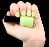 Nail polish in hand, close-up — Stock Photo