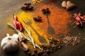 Spices on table with cutlery silhouette — Stock Photo
