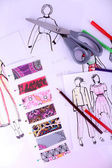 Sketches of clothes and fabric samples — Stock Photo
