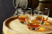 Glasses of brandy in cellar — Stock Photo