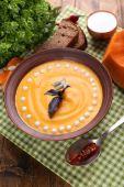 Pumpkin soup in plate — Stock Photo