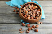 Hazelnuts in wooden bowl — Stock Photo