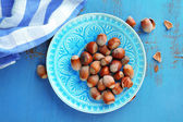 Hazelnuts in plate on table — Stock Photo