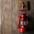 Lantern hanging on hook on wooden wall — Stock Photo #60779281