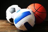 Sports balls on black background — Zdjęcie stockowe