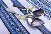 Spoons on fabric background — Stock Photo